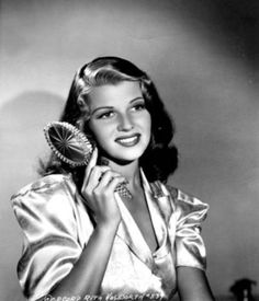 Rita Hayworth being photograph in her boudoir during the time she did You'll Never Get Rich