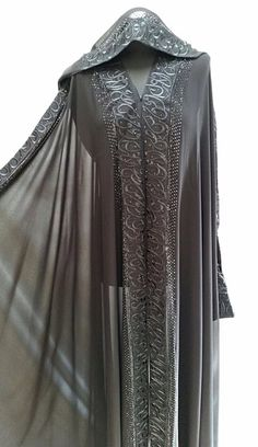 SOLD! Elegant cloak decorated with Arabic calligraphy and black diamanté. Option of wearing with hood. Transparent fabric.  Size 56.  Ref: 32