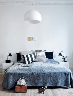 Black, white, and grey bedroom. Nice light fixture.