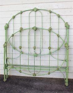 "This shade of ""green"" was one of the most popular colors being used in the early 1800's. This ""wedding ring"" style bed still has it's original paint job with subtle gold accented castings. #ironbeds #antiqueironbeds"