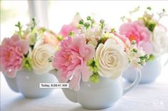 statement flowers with filler pieces... brandy snifters instead of teapots