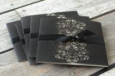 Beauty and the Beast style wedding invites. Belle knows that it's what's inside that counts - but it doesn't hurt when the outside is a thing of beauty, too! This wedding invitation symbolizes those sentiments perfectly with an intricately embossed and laser cut black wrap surrounding an ecru shimmer invitation card.