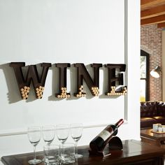 """Collect wine corks from the bottles you enjoy and display those wonderful wine memories in this artful piece of wine decor. Hang the Danya B Metal """"Wine"""" Letters Cork Holder on your home bar or kitchen and keep track of how much wine you've enjoyed!"""