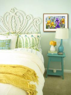 Looking for a bright decorating idea for your bedroom? Add a sunny yellow throw and pop in some color with a purple and yellow iris floral watercolor painting! $99 This flower art ties in the aqua grays, teals and yellows plus the purple gives additional vibrancy to the room. Collect the art : https://www.etsy.com/listing/121477448/original-floral-watercolor-art-iris