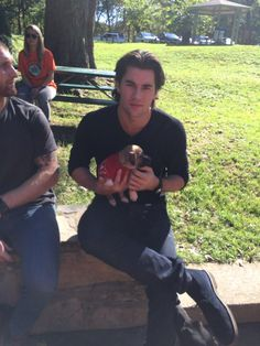 Washington Capitals: Tom Wilson and a puppy from Homeward Trails Animal Rescue during the 2015 Caps Canine Calendar photo shoot