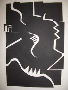 shape quake divide a piece of balck construction paper then glue to a bigger white paper creating amazing movement with line and contrast.