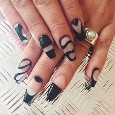 A black, white and sheer themed abstract nail art design. The black polish is wonderfully designed on the nails making it look like a huge canvas with hints of French tips on some of the nails.