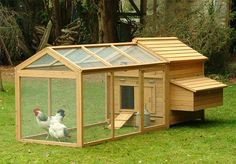 Attractive wooden chicken house with a plastic drinker and feeder.