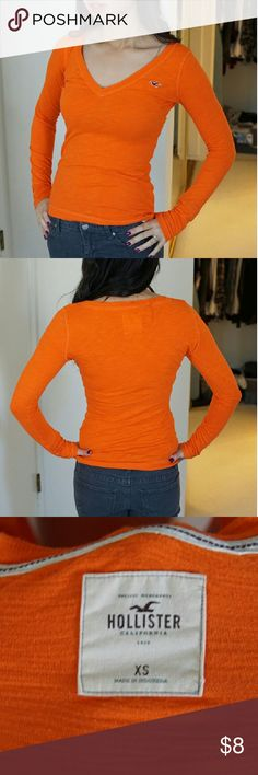 Hollister fitted orange V-neck Hollister fitted orange V-neck. Size xs. Brand new never worn just gathering dust in my closet. Comfortable. Hollister  Tops Tees - Long Sleeve