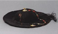 Yuan Dynasty. Brimmed hat. Fiber, wood, gold, and semiprecious stones. The tops of such hats are ornamented, and a string of hardstone beads serves as a decorative chin band, similar to that of the brimrned hat in the tapestry-woven portrait of Tugh Temiir. Height is 9.2 cm. Diameter of headband is 18c m. Outer diamter is 35 cm. Excavated from the Wang Shixian family tombs, Zhangxian, Gansu Province. Gansu Provincial Museum.