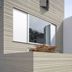 The Stripe House is a modest, mixed-use home in the Netherlands. Designed by GAAGA, this three story house is named for the horizontal stripes carved into the facade on three sides of the structure. The groves were hand-carved into the plaster, creating a unique display of craftsmanship.