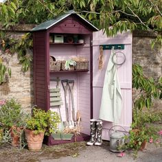 A freshly pastel-painted garden shed