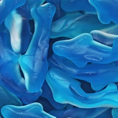 Gummy Sharks from Temptation Candy. I think we're going to need a bigger boat! Great choice for candy buffets and parties. Sold in 5 lb bags, comes in two sizes: 2 inches and 4 inches. Candy Theme, Candy Party, Blue Candy, Rock Candy, Ice Cream Cookies, Shark Party, Plan My Wedding, Sugar Rush, Candy Buffet