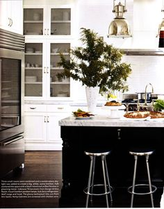 White cabinets, marble countertops, industrial glass door refrigerator, my dream kitchen!