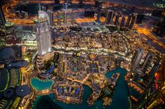 The view from the tallest building in the world - Burj Khalifa/Dubai.<br />The observation deck was very crowded. People waited in line to the window. When I finally managed to get to the window I saw this amazing view and I took the picture.