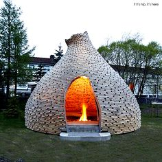 This unusual Outdoor Fireplace (also called Fireplace For Children) by architects Haugen/Zohar was inspired by traditional Norwegian turf huts.