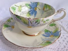 Paragon China Tea Cup and Saucer, Hand Painted Blue Floral on Light Yellow, 1933-34