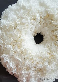 It's easy to make this stunning (and cheap) coffee filter wreath! The full tutorial is available at diy beautify!