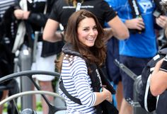 Kate smiles as she gets ready to take William DOWN.