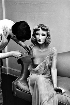 Mannequin artist Lester Gaba making an adjustment to his lifelike mannequin Cynthia, created for Saks Fifth Avenue, photo by Alfred Eisenstaedt, c.1937