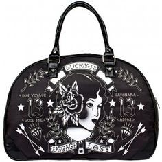 """LUCKY 13 LUGGAGE LOST TRAVEL BAG  No need to worry about Lost Luggage when you travel with Lucky 13! This black polyester overnight bag features a traditional tattoo inspired gal in the center surrounded by tattoo filler & banners that read """"Lucky 13...Luggage Lost"""" around her. Bag features sturdy faux leather handles & zip top.  $44.00"""