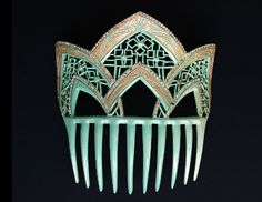 this celluloid Art Deco American comb with gold paint, whose blue is the same color as a Tiffany & Co. shopping bag,