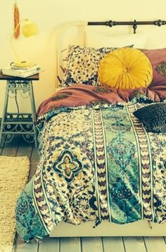 Boho chic yellow, turquoise and plum bedroom