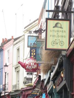 Little shops on Portbello Road in Notting Hill including Stumper and Fielding Men's Clothing and the Antique Arcade.