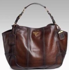 Celebrities who wear, use, or own Prada Cervo Antik bag. Also discover the movies, TV shows, and events associated with Prada Cervo Antik bag. Burberry Handbags, Gucci Handbags, Hobo Handbags, Luxury Handbags, Purses And Handbags, Leather Handbags, Hobo Purses, Handbags Online, Designer Handbags