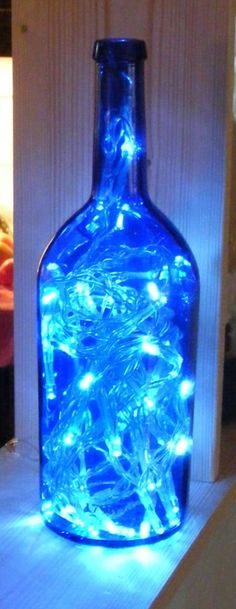 47 Amazing Diy Bottle Lamp Ideas - Hand crafted Lighted Bottles and Lamps make wonderful and unique gifts for every day and any special occasion. It is a fairly simple process to turn a. Empty Wine Bottles, Wine Bottle Corks, Lighted Wine Bottles, Diy Bottle, Bottle Lights, Wine Bottle Crafts, Glass Bottles, Wine Bottle Lamps, Wine Bottle Chandelier