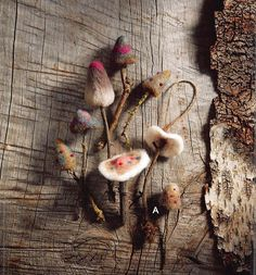 The Roost Woodland Felt Mushroom Ornaments are delightful, diminutive mushrooms with soft-hued colorations are crafted from expertly needle-felted wool. Natural moss and lichen-adorned twig stems vary in len