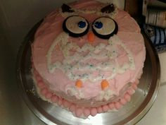 Owl cake! Double layer confetti cake with strawberry shortcake frosting! Oreos and m for the eyes chewy nerds for the beek and feet! So easy!!