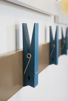 oversized clothes pins to hang kids artwork.What the heck.I need these just to hang my clothes! Regular hangars are just so damn small. Hanging Kids Artwork, Displaying Kids Artwork, Artwork Display, Kids Art Galleries, Toy Rooms, Kids Corner, Kid Spaces, Diy Home, Art For Kids