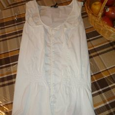 Summer sleeveless top WHITE airy top ..gathers on either side of the waste. And hangs a little longer than an average summer shirt. Daisy Fuentes Tops Tank Tops