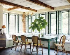 dining nook. love the built in benches and green table.