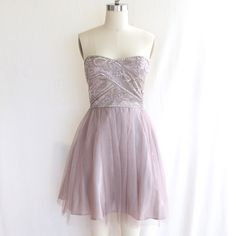 Beaded Taupe Strapless Dress Such a gorgeous beaded bodice strapless dress for prom! This fairytale dress is fit for a princess! In the photos it looks almost lavender or ivory, but it's true color is taupe. Worn only once. Excellent condition! Jump Apparel by Wendye Chaitin Dresses Prom