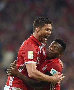 Bayern Munich's Spanish midfielder Xabi Alonso and Bayern Munich's Austrian midfielder David Alaba celebrate a goal during the German first division...