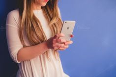 Check out Blonde woman with Iphone by Seronda Estudio on Creative Market
