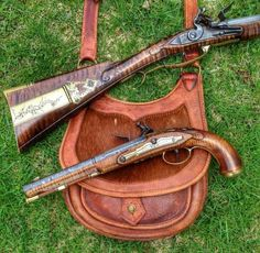 pistol is a kentucky by the furniture and style of the stock as well as the rifle , possibly a berks county, the butt plate is not as pronounced