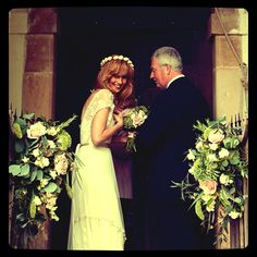 Kelly Reilly and her father waiting to enter the wedding chapel by Ria Mishaal Photography