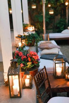 cozy cushioned benches...glowing lanterns and strands of globe lighting...
