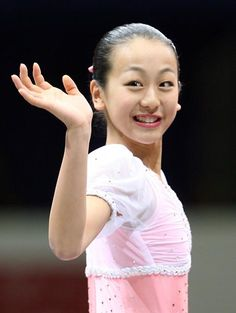 Winner Mao Asada of Japan poses for photographers after competing in the Ladies' event of the Grand Prix of Figure Skating Final at Yoyogi. Figure Skating, Ballet Skirt, Japan, Poses, Lady, Grand Prix, Photographers, Smile, Figure Poses