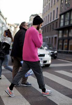 man wearing pink sweater
