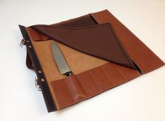 New design, holds 12 knives and has a zippered pocket. Check on Etsy or Amazon.
