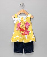 This set is as sweet as honey, and Winnie the Pooh knows it too. Whimsical ruffles and bright colors make this piece an instant hit in the Hundred Acre Wood.• Includes tank and jeans• 100% cotton• Machine wash; tumble dry• Imported