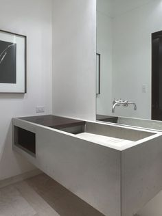 Concrete sink inside the Concrete House by Ogrydziak and Prillinger Architects. Nice.