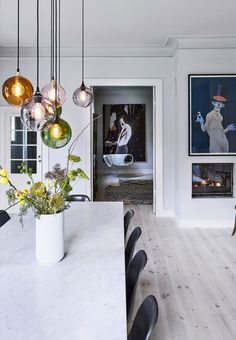 Beautiful pendants over the dining table in different colors.