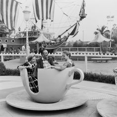 Walt Disney, his wife, Lillian, and their daughter, Diane, ride a spinning tea cup at Disneyland, shortly after its opening (1955)