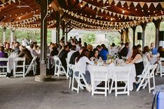 Bunting and pretty pavilion outdoor wedding.