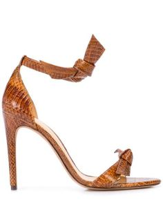Walnut chocolate leather snake-effect tie front sandals from Alexandre Birman featuring a bow on the front, a wrap tie ankle fastening, a snakeskin effect, a branded insole, a leather sole and a high stiletto heel. Stiletto Heels, High Heels, Shoes Heels, Flat Shoes, Alexandre Birman, Burberry Handbags, Brown Sandals, Fashion Shoes, High Fashion